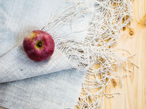 Apple on the tablecloth Stock Photo