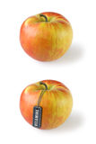 Apple with tag Vitamins Stock Images