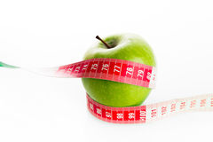 Apple with tailor s ruler. Fruit healthy vitamin diet Stock Image