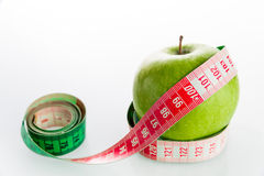 Apple with tailor s ruler. Fruit healthy vitamin diet Stock Photos