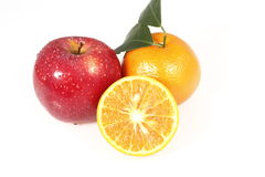 Apple and tangerine Stock Photography