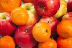Apple, Tangerine and Oranges Stock Photos