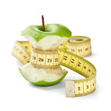 Apple and tape. Close up of  an apple measuring tape on white background with clipping path Stock Image