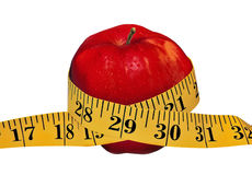 Apple With Tape. Depicted is a red apple with the measuring tape- isolated over white Royalty Free Stock Photos
