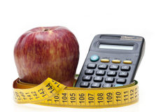 Apple, tape and calculator Royalty Free Stock Photos