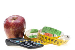 Apple, tape and calculator Stock Photos