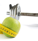 Apple, tape and dumbbell Stock Image