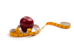 An apple with a tape measure Stock Images