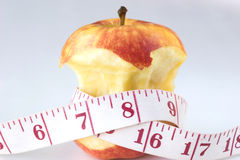 Apple and tape measure. On a white background royalty free stock images