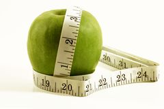 Apple and tape measure Royalty Free Stock Photo