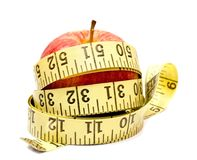 An apple and a tape measure. Isolated on white Stock Photo