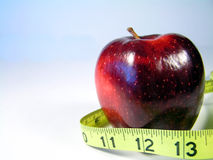 Apple and tape measure 2 Royalty Free Stock Image
