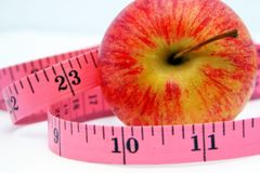Apple and Tape Measure 2 Stock Photos
