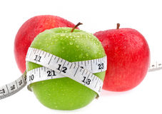 Apple with tape measure. Isolated on white background. Healthy lifestyle concept Stock Images