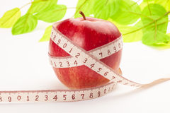 Apple with a tape measure Stock Photo