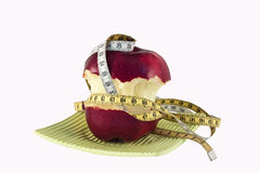 Apple and tape measure Stock Photography