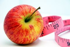 Apple and Tape Measure 4 Stock Photography