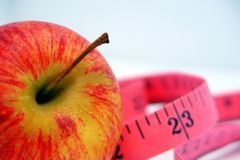 Apple and Tape Measure  Royalty Free Stock Images