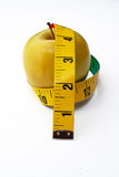 Apple with tape measure. Yellow Apple with tape measure stock photos