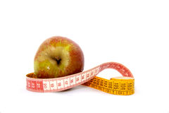 Apple with tape-measure Royalty Free Stock Photos