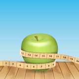 Apple and tape measure Stock Image