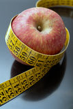 Apple with tape measure Royalty Free Stock Image