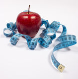 Apple and tape measure, diet concept Stock Images