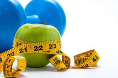 Apple with a tape measure and a dumbell Stock Image