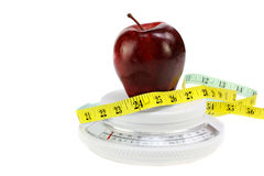 Apple, Tape Measure on Food Scale Royalty Free Stock Photography
