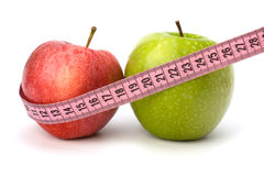 Apple with tape measure. Healthy lifestyle concept. Royalty Free Stock Photography