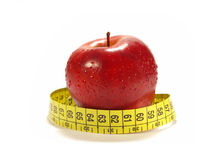 Apple and tape measure isolared Royalty Free Stock Photo