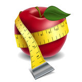 Apple with tape measure. Red apple with yellow tape measure isolated on white Royalty Free Stock Images