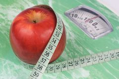Apple, tape measure and scale Royalty Free Stock Image