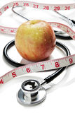 Apple, tape measure and stethoscope Royalty Free Stock Photo