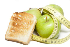 Apple with a tape measure and toast Stock Photos