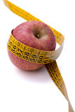 Apple with tape measure Stock Images