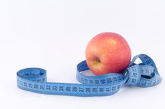 Apple with Tape Measure. On a white background stock images
