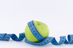 Apple with Tape Measure. On a white background stock photos