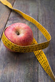 Apple with tape measure Royalty Free Stock Photography