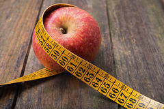 Apple with tape measure Stock Photography