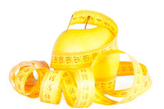 Apple and tape of measurements. Stock Photos