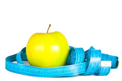 Apple and tape of measurements. Royalty Free Stock Photography