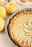 Apple tart. Delicious apple tart and ingredient on table Royalty Free Stock Photography