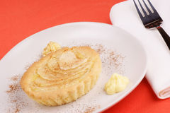 Apple tart. With lemon custard and cinnamon served on a white plate Stock Image