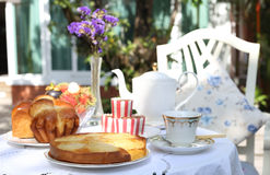 Apple tart with bread and fruit at tea time. In the garden Royalty Free Stock Images