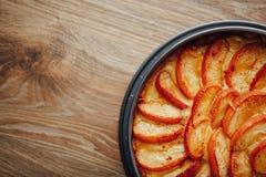 Apple tart cake on wooden table top Stock Photo