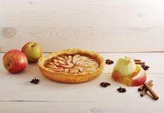 Apple tart with cinnamon and apples. On a white wooden background Stock Photo