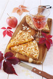Apple tart, colorful leaves and wineglass Stock Image