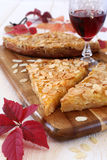 Apple tart, colorful leaves and a wineglass Royalty Free Stock Photo