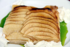 Apple tart with cream. On plate Royalty Free Stock Photos